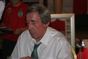 Gordon Banks seated, signing